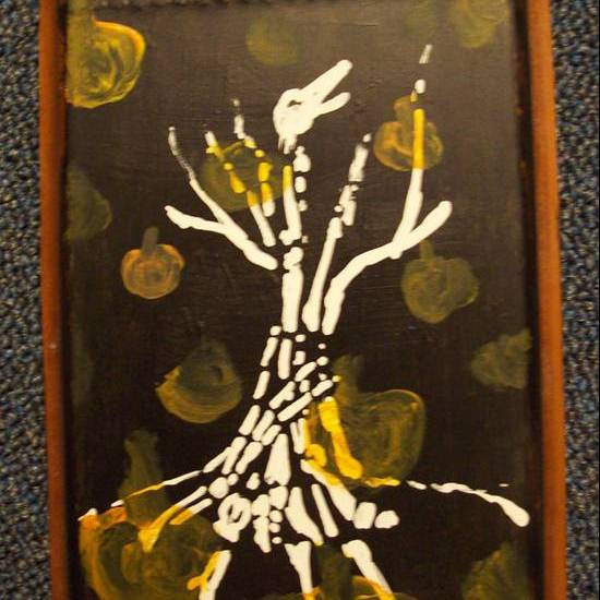 Skeleton tree with pumpkins